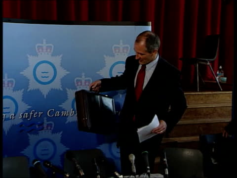 phone call deadline lib england cambridgeshire soham int detective superintendent david beck taking seat at press conference - conference phone stock videos & royalty-free footage