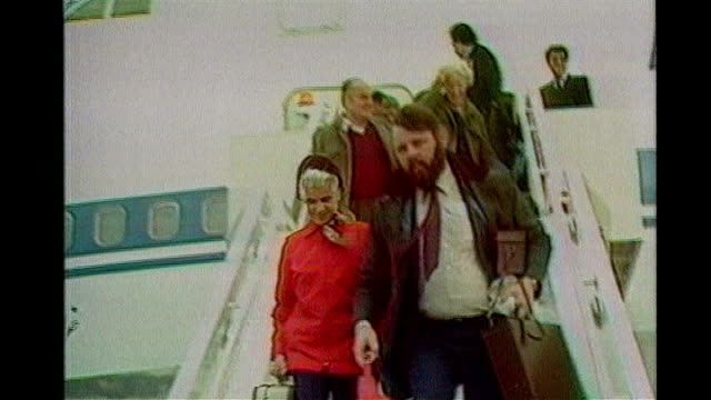 report highlights effect on families LIB Lyneham EXT Terry Waite down aircraft steps on return to UK