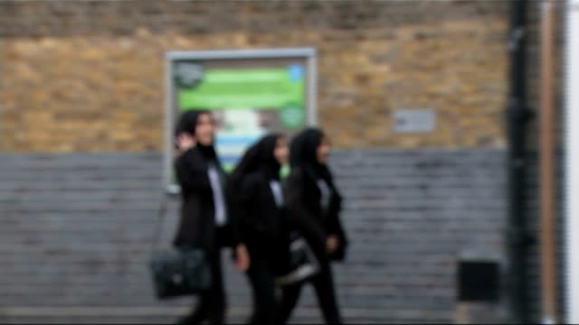 missing schoolgirls believed to be travelling to syria search continues england east london bethnal green bethnal green academy and pupils along... - bethnal green stock videos & royalty-free footage