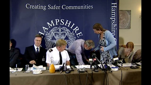 Parents appeal for return ENGLAND Hampshire PHOTOGRAPHY** Police officers and family members including Robert Edwards arriving at press conference...