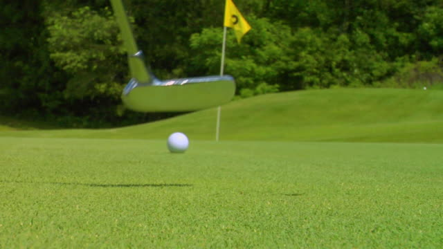 missing the hole - golf flag stock videos and b-roll footage
