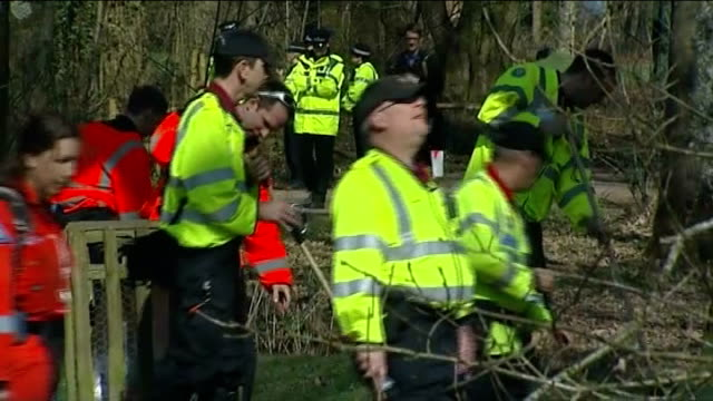 missing woman sian o'callaghan: police search continues; england: wiltshire: savernake forest: ext various of police officers searching woodland for... - wiltshire stock videos & royalty-free footage