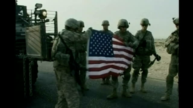 location unknown soldiers posing with stars and stripes flag - 2010 video stock e b–roll