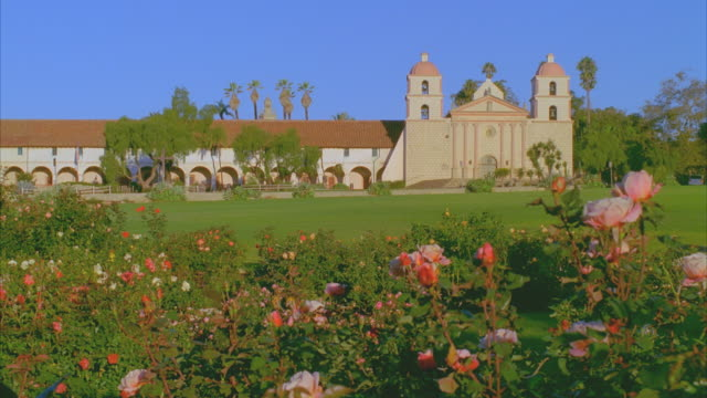 ws mission santa barbara with roses in foreground / california, usa - santa barbara california stock videos & royalty-free footage