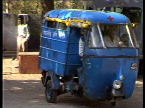 stockvideo's en b-roll-footage met missionaries of charity van drives around streets delhi 1983 - van