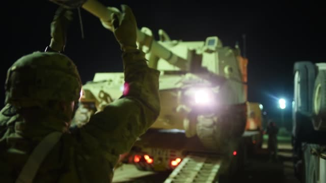 mississippi army national guard soldiers load vehicles onto low loader trailers at camp buehring kuwait in preparation to turnin army prepositioned... - national guard stock videos and b-roll footage