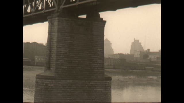 vidéos et rushes de mississippi river front archival showing industrial structures and riverboats / cityscape and hotel york - nostalgie