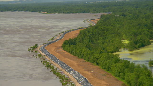 Mississippi River levee covered with sandbags and plastic as it faces rising flood waters/ Clarksville Missouri