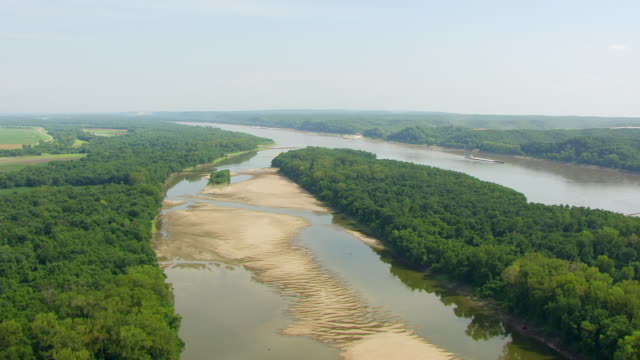 WS AERIAL POV Mississippi River with forest area / East St. Louis, St. Clair County, Illinois, United States