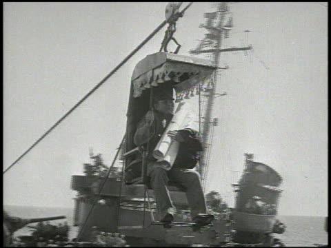 missouri battleship at sea japanese harbor pilot being transferred to uss missouri from accompanying ship int vs japanese officers amp united states... - 軍艦点の映像素材/bロール