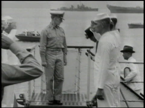 stockvideo's en b-roll-footage met missouri docked in tokyo bay vs japanese minister of foreign affairs mamoru shigemitsu amp delegates coming aboard uss missouri standing on deck w/... - hogehoed