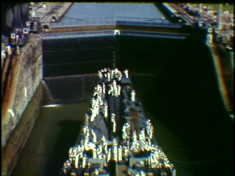 missouri naval warship passing through flood gates in panama canal panama - uss missouri stock videos and b-roll footage