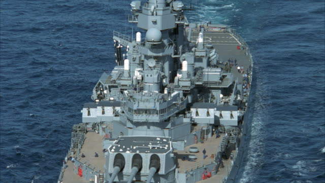 low aerial, ms uss missouri on sea - militärschiff stock-videos und b-roll-filmmaterial