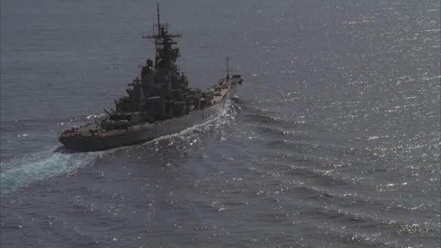 low aerial, zi, uss missouri on sea - uss missouri stock videos and b-roll footage