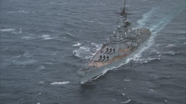 low aerial, circling, uss missouri on sea - uss missouri stock videos and b-roll footage