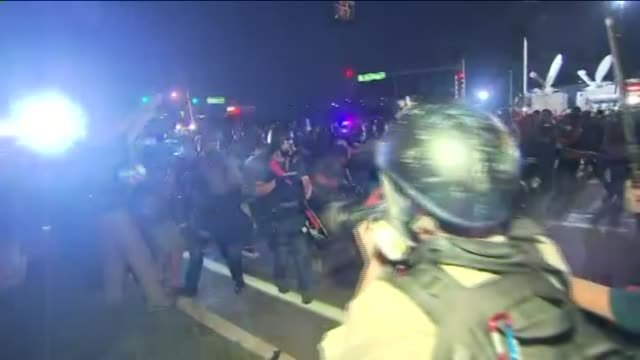 missouri police and protestors clash in ferguson smoke bombs and tear gas fired in streets on august 18 2014 in ferguson missouri - police brutality stock videos and b-roll footage