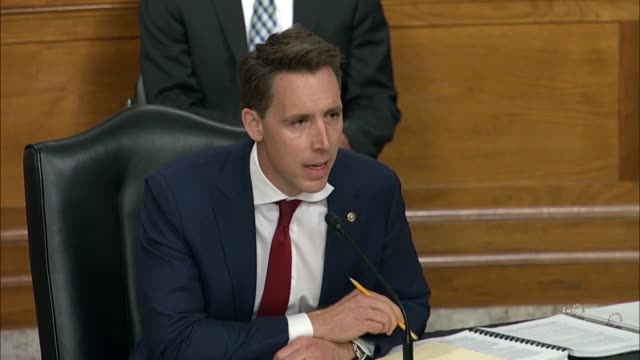 missouri senator josh hawley continues an exchange with former fbi director james comey at a senate judiciary committee hearing in review of the 2016... - an answer film title stock videos & royalty-free footage