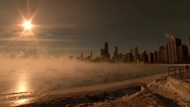 mist blowing off of lakemichigan with the chicago skyline in the background during a polarvortex currently impacting much of the united states - willis tower stock videos & royalty-free footage