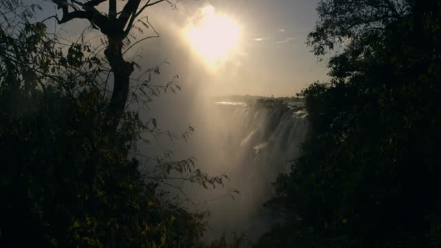 mist cloud forms at victoria falls, zambia - spray stock videos & royalty-free footage