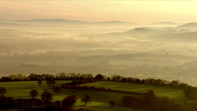 mist covering green countryside - morning dew stock videos & royalty-free footage