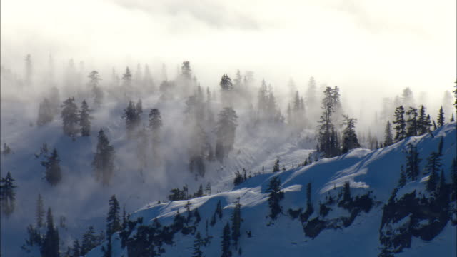 mist drifts across snowy mountain ridges of the cascades mountains. - winter stock videos & royalty-free footage