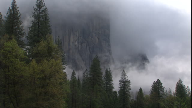 mist drifts in front of yosemite national park's el capitan. - el capitan yosemite national park stock videos and b-roll footage