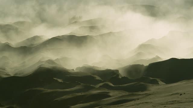 mist drifts over sand dunes, java. - sand dune stock videos & royalty-free footage