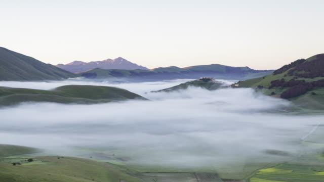 A mist filled Piano Grande in Umbria.