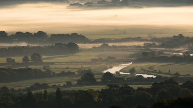 mist hangs in the valley near amberley in the south downs national park on october 3 2018 in amberly united kingdom - fog stock videos & royalty-free footage