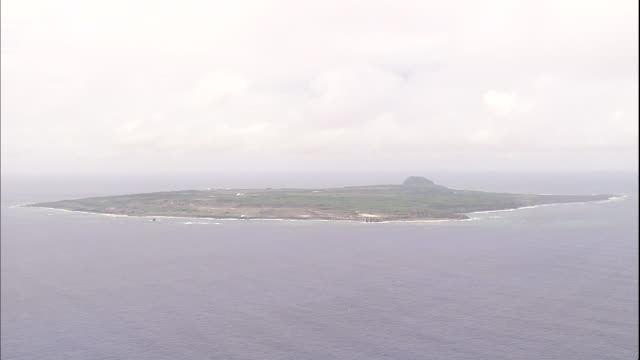 a mist hangs over iwo jima island in the pacific ocean. - iwo jima island stock videos & royalty-free footage