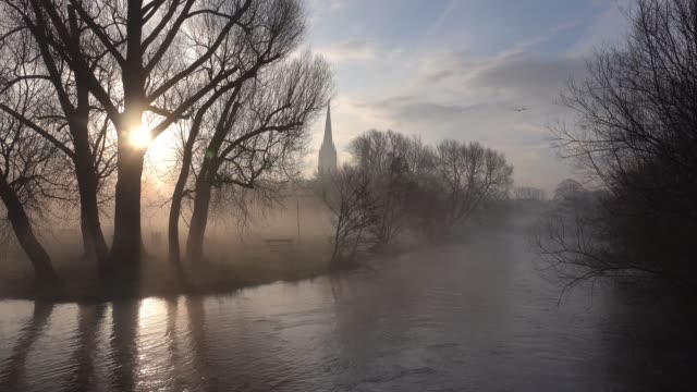 mist lingers as the sun rises over salisbury cathedral in salisbury, on march 7, 2018 in wiltshire, england. sergei skripal, who was granted refuge... - fog stock videos & royalty-free footage