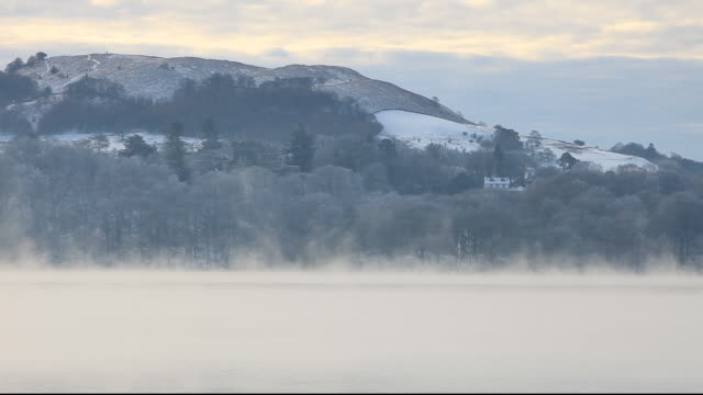 mist on lake windermere on a cold winters morning, ambleside, lake district, uk. - wispy stock videos and b-roll footage
