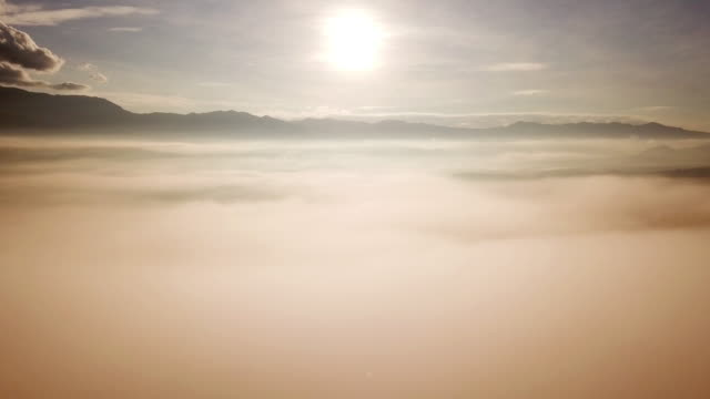 mist on the mountain aerial shot with morning sunrise - condensation stock videos & royalty-free footage