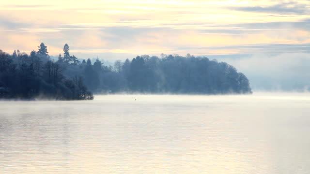 vídeos de stock, filmes e b-roll de mist over a lake - water form