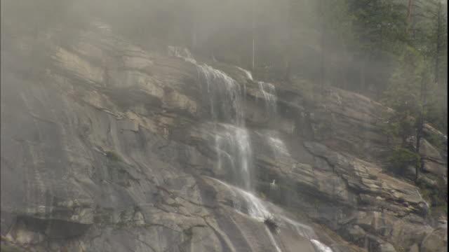 mist partially obscures bridalveil falls in yosemite national park, california. - bridal veil falls yosemite stock videos & royalty-free footage