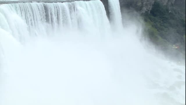 mist rises from niagara falls. - river niagara stock videos & royalty-free footage