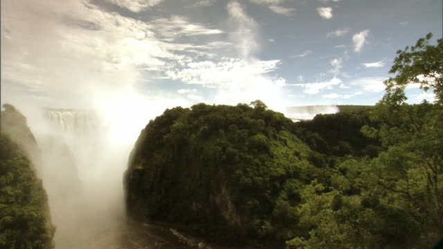 Mist rises from Victoria Falls.