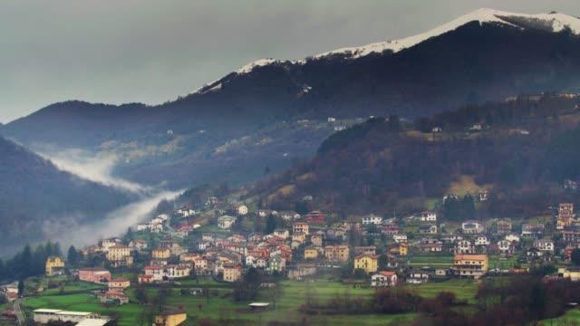 Mist Snaking Down Valley Near Cerano D'Intelvi, Italy - Aerial View