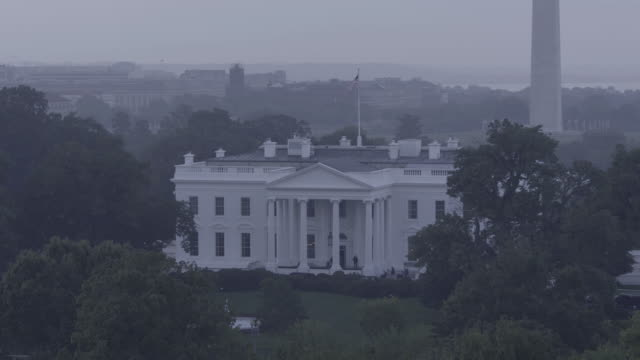 A mist surrounds the White House and nearby Eisenhower Executive office Building.
