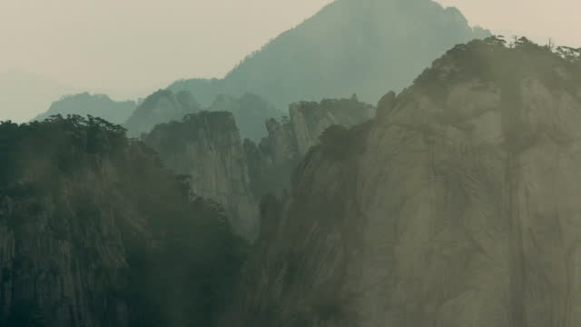 mist wraps around rock formations, china - fog stock videos & royalty-free footage