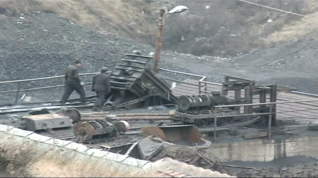 Mistreatment of coal miners EXT Coal miners working on coal mine Men shovelling coal in carts