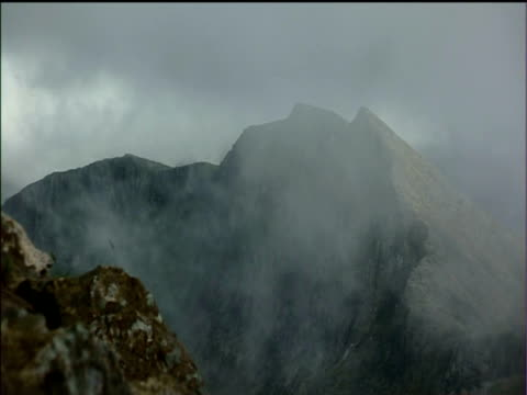 misty cloud obscures mountain ridge snowdonia national park - snowdonia stock videos & royalty-free footage