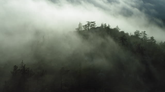 Misty Clouds Move Past Mountain