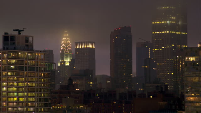 misty clouds over midtown manhattan - manhattan stock videos & royalty-free footage