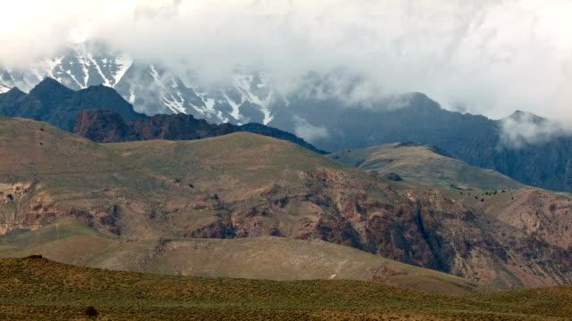 Misty cloudy mountain with snow Alvord Desert Steens Mountain Near Malhuer Wildlife Refuge 5