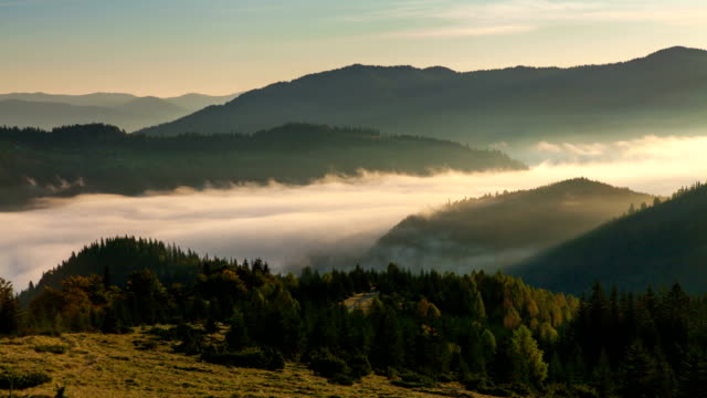 Misty dawn in the mountains. Beautiful landscape. Timelapse