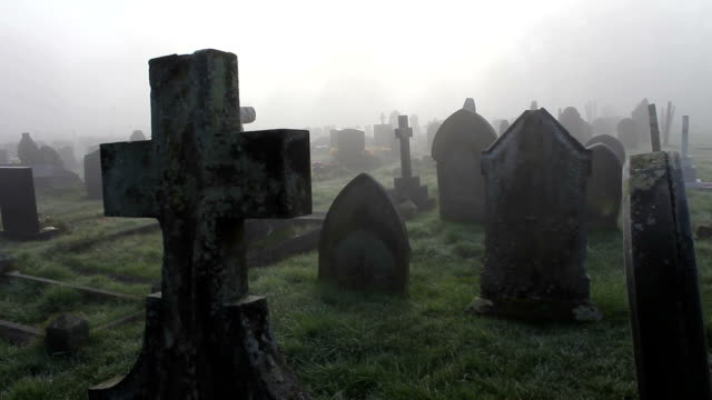 misty foggy spooky graveyard with old tombstones and grave headstones - cemetery stock videos & royalty-free footage