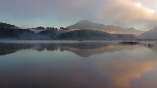 misty lake - vietnam stock videos & royalty-free footage