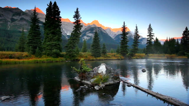 Misty Mountain river in the Canadian Rockies and Alpine Glow