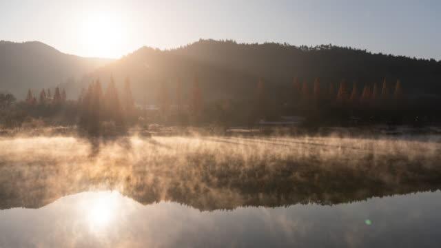 misty obongje reservoir at sunrise / naju-si, jeollanam-do, south korea - gazebo stock videos & royalty-free footage